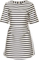 beyonce knowles  Who made Beyonce Knowles white stripe dress and black pumps?