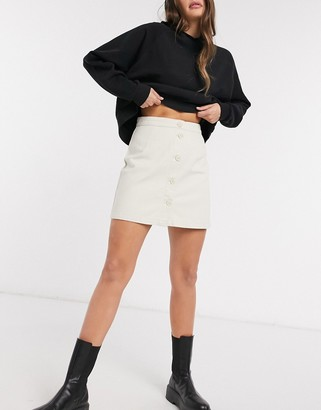 Monki Rio button front mini skirt in white