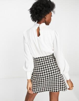 Little Mistress 2-in-1 check boucle skirt mini dress in monochrome