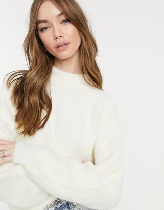 Bershka fluffy knit jumper in cream