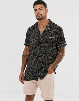 Jack and Jones animal print revere collar short sleeve shirt in black