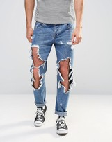 Asos Slim Jeans With Open Rips In Mid Blue