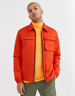 ASOS DESIGN quilted jacket with utility details in orange