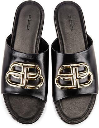Balenciaga Ovall BB Slides in Black & Gold | FWRD