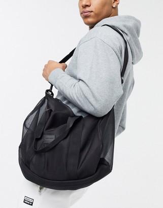 ASOS DESIGN barrel bag in black mesh