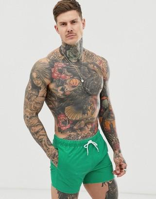 Asos Design DESIGN swim shorts with green acid wash in short length