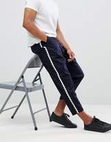 Asos Design ASOS DESIGN wide balloon cropped trousers in navy with wave side taping