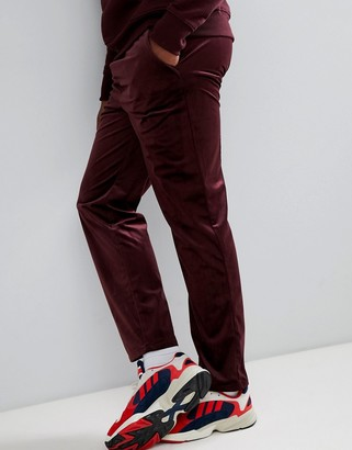 Asos Design DESIGN slouch fit trousers in burgundy velour-Red