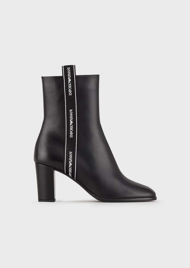 8de9845170 Leather Heeled Booties With Logo Strap