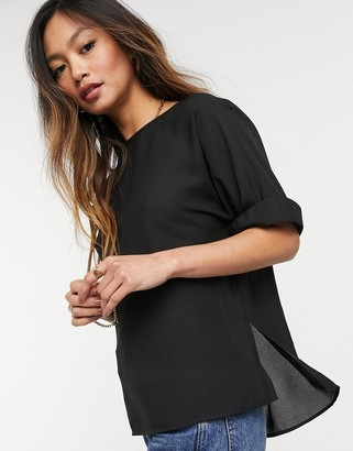ASOS DESIGN oversized woven tee with roll sleeve in black