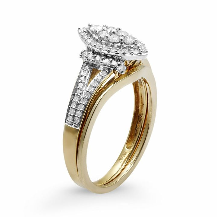 Diamond marquise halo engagement ring set in 10k gold (1/2 ct. t.w.)