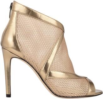 Gold Peep Toe Booties | Shop the world