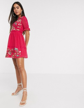 ASOS DESIGN embroidered mini dress with lace trims in hot pink