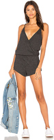 Chaser Drapey Surplice Romper in Charcoal. - size XS (also in )