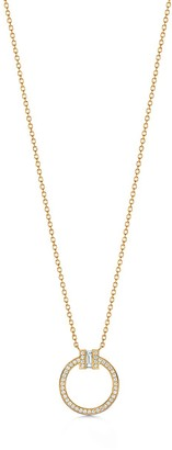 Tiffany & Co. T diamond pendant in 18k gold with a baguette diamond