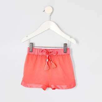 River Island Mini girls neon pink sheer beach shorts
