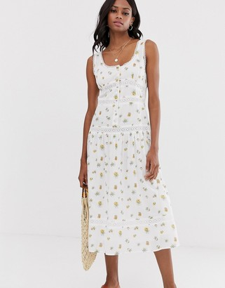 Asos Design DESIGN sleeveless lace insert midi dress with dropped waist in floral print