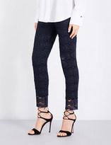 St. John Skinny metallic floral-lace trousers