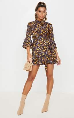 PrettyLittleThing Black Floral Frill Hem Wrap Front Tea Dress