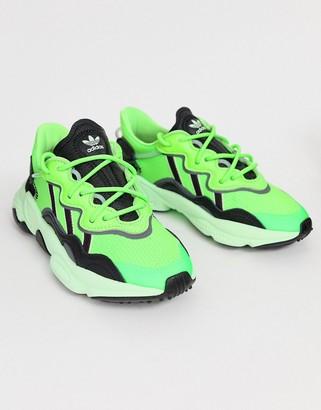 adidas Ozweego trainers in solar green