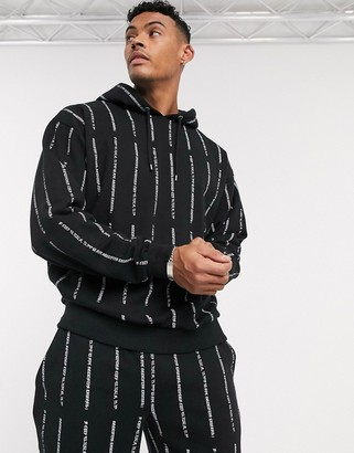 ASOS DESIGN two-piece oversized hoodie in black with white text stripe print