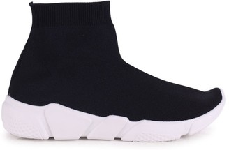 Linzi COURTESY - Black Sock Trainer With Chunky White Rubber Sole
