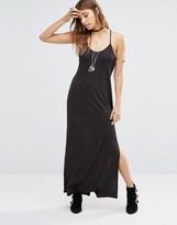 Free People She Moves Maxi Slip Dress in Black