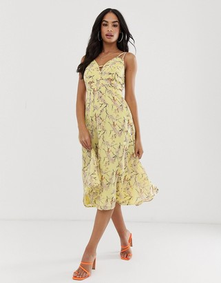 Asos DESIGN midi dress with cami straps and cut out detail in floral print