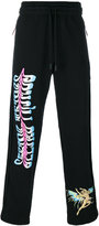 Off-White bird print track pants - men - Cotton - XS