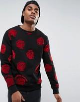 Criminal Damage Sweatshirt In Black With Rose Print