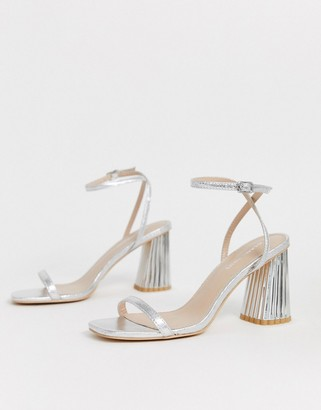 Glamorous silver heeled sandals with statement heel