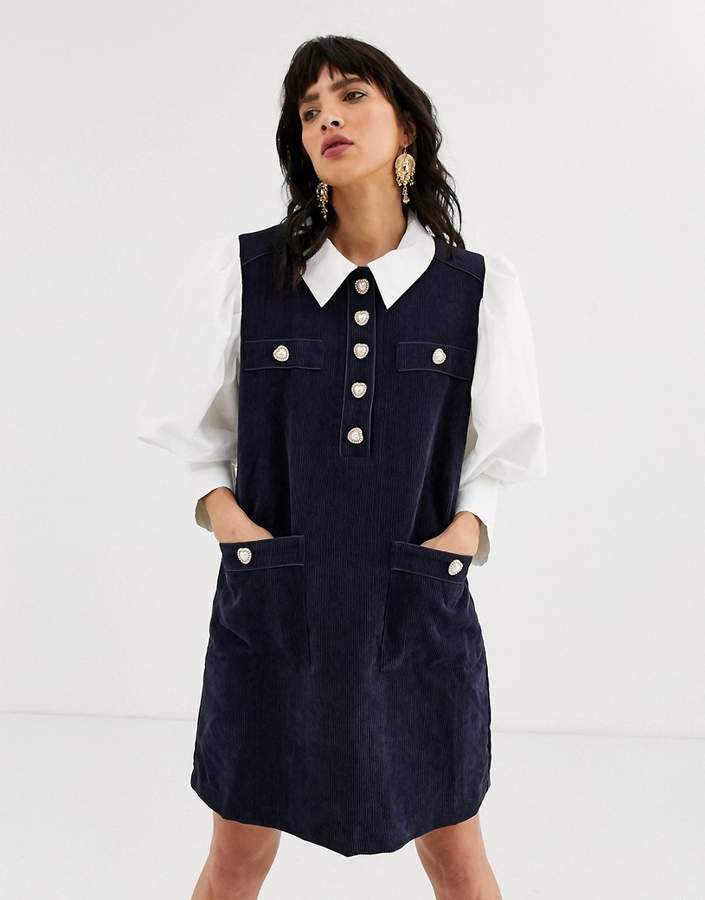 Sister Jane pinafore dress with shirt layer and heart buttons in cord