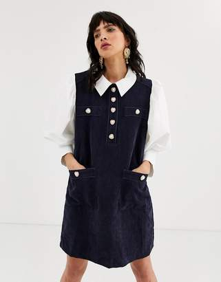 Sister Jane pinafore dress with shirt layer and heart buttons in cord-Navy