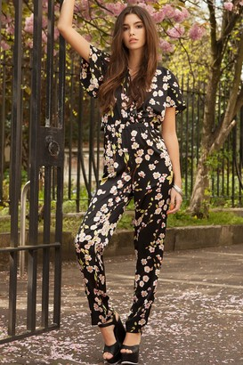 Girls On Film Floral Print exposed Back Jumpsuit