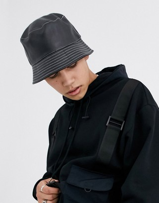 ASOS DESIGN bucket hat in black faux leather with white contrast stitch