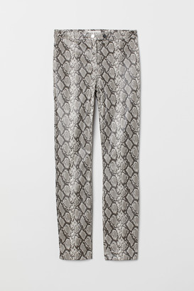 H&M Snakeskin-patterned trousers