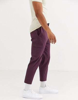 ASOS DESIGN skinny smart pants in burgundy cotton with cargo pockets