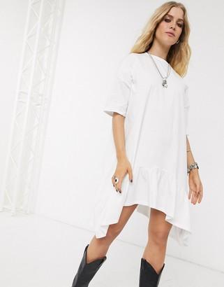Asos DESIGN oversized smock dress with tiered dip hem in white