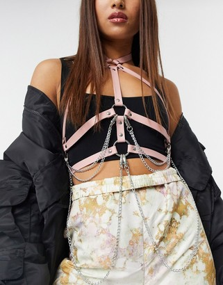 ASOS DESIGN strap harness with hanging chain detail in pink
