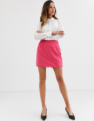 Glamorous mini skirt with scalloped hem