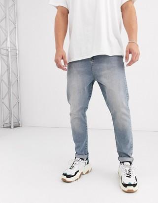ASOS DESIGN relaxed jeans in vintage light wash blue