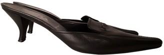 Prada Black Leather Mules & Clogs