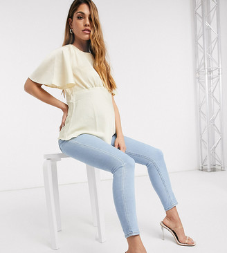 Asos DESIGN Maternity Ridley high waist skinny jeans in bright lightwash blue with over bump waistband