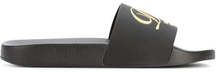 Dolce & Gabbana Black luxury hotel pool slides