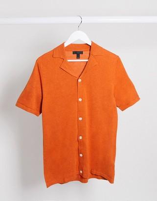 ASOS DESIGN knitted button through polo t-shirt in orange
