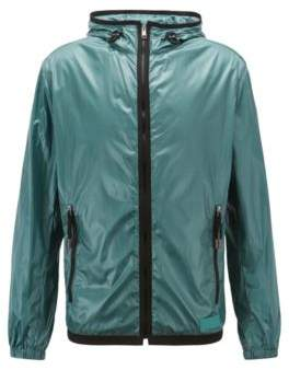 Hooded windbreaker jacket in lightweight fabric with glossy finish