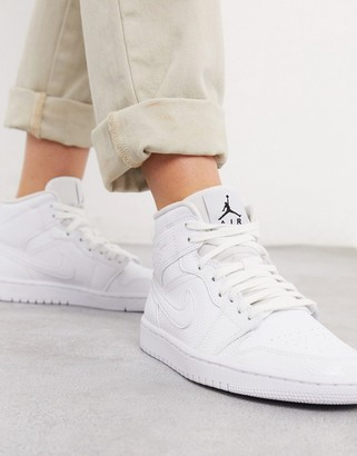 Jordan Air 1 Mid trainers in white