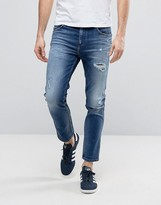 Calvin Klein Jeans Rip & Repair Mid Wash Jeans In Slim Fit