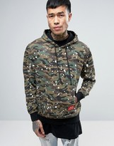 Reason Camo Hoodie With Paint Splat And Back Print