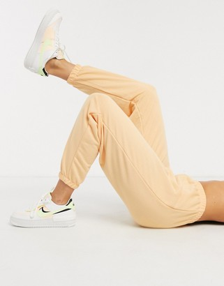 ASOS DESIGN lounge pants in washed peach